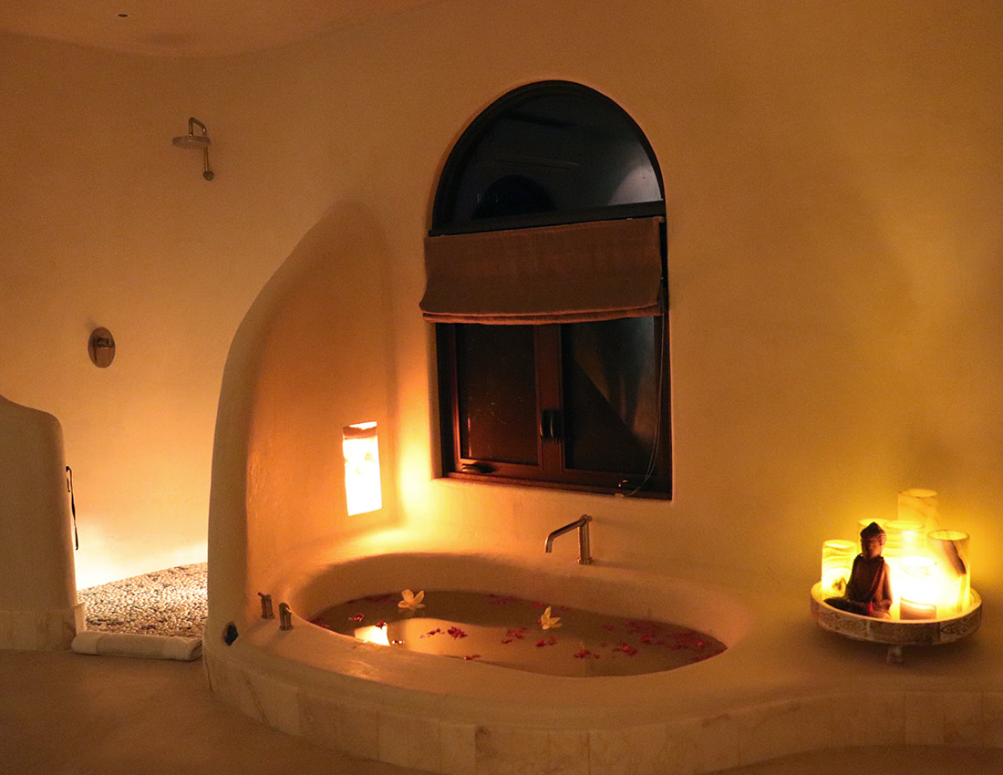 casa kamala master bathroom spa tub evening
