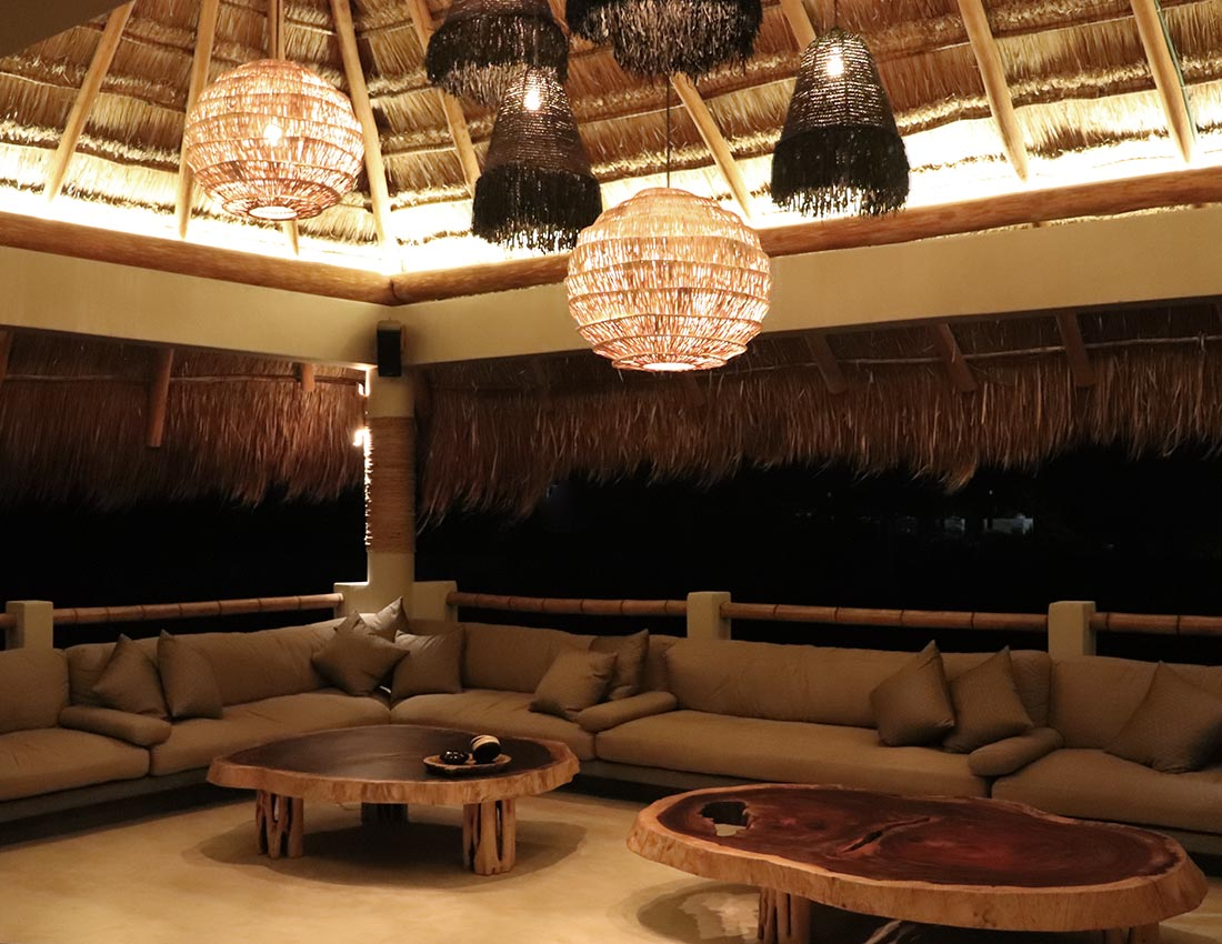 rooftop palapa lounge area evening