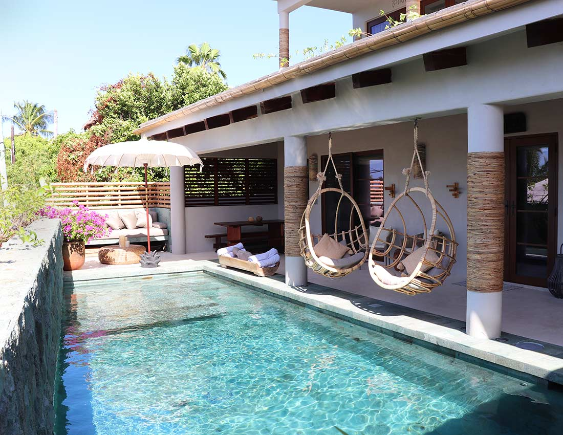 swinging hammock chairs veranda and salt water pool with sukabumi tile